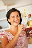 Young woman drinking at bar