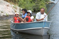 African family fishing in rowboat