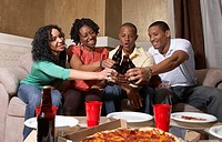 Multi-ethnic friends having pizza party