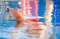Side view of woman in swimming pool