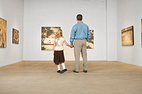 Father and daughter in art gallery