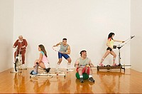 People exercising on exercise machines