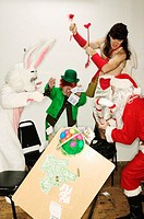 Holiday mascots wrecking a card table