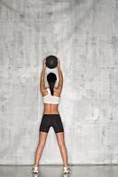 Female athlete using exercise ball