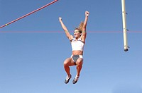 Female athlete pole vaulting