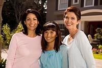 Multi-generation family of women smiling