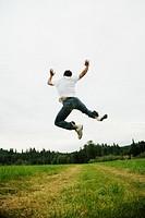Man jumping in field