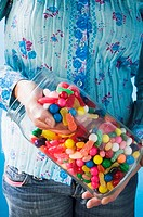 Hand taking sweets out of jar