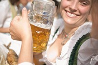 Women clinking two litres of beer together Oktoberfest, Munich