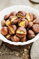 Roasted chestnuts in white bowl