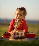 A young girl having a birthday picnic