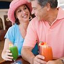 Couple having tropical drinks at bar