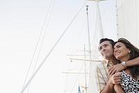 Couple hugging on ship