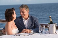 Couple having romantic dinner on boat deck