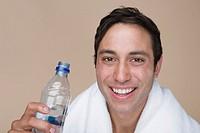 Man drinking from water bottle