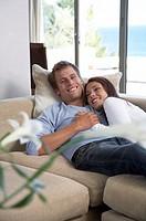 Couple relaxing on sofa