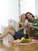 Couple having break in new flat