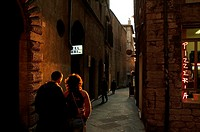 Rear view of a man with a woman walking on the street, Via Dei Priori, Perugia, Umbria, Italy