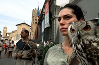Close-up of a mid woman with an owl, Orvieto, Umbria, Italy