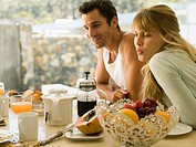 A couple at the dining table for breakfast