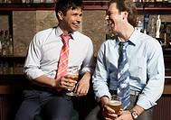 Businessmen having drinks in bar