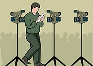 Man writing on paper near video cameras