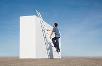 Man climbing ladder against wall outdoors