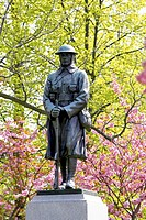 Memorial statue surrounded by cherry trees in blossom, Canada, Ontario
