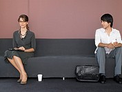 Businesswoman and Businessman in Office Lobby