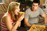 There´s no way to eat a pizza with dignity, young girl and friend eating competition.