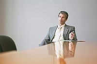 Businessman siting at conference table