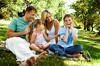 Mid adult couple with their children at a picnic
