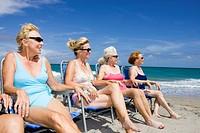 Group of senior women in beach chairs