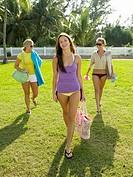 Teenage girls walking on lawn