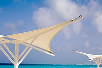Mexico, Mayan Riviera, umbrellas on the beach.