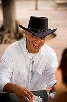 Senior man playing dominos