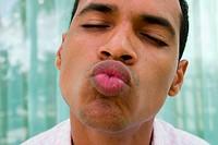 Young man kissing
