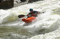 Kayaker Negotiating the River