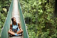 Woman Sitting on Bridge in Wilderness Area