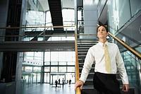 Businessman on Stairway in Office
