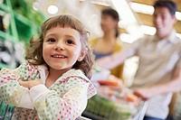 Girl in Shopping Cart