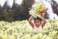 African American girl in field of spring flowers