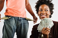 African American woman holding money next to man with empty pockets