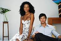 South American couple sitting on chair