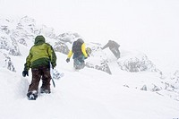 Snowboarders Walking Up Hill