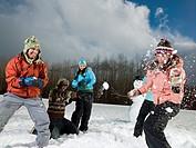 Friends Having Snowball Fight