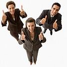 Multi-ethnic businesspeople giving thumbs up