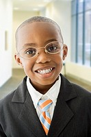 African American boy dressed in business suit