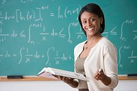 African American female teacher holding text book