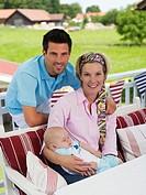 Parents with baby in garden